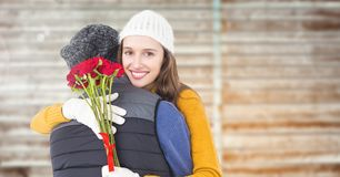 Couple with rosses embracing each other Royalty Free Stock Photos