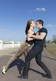 A couple roundly dancing on the brick road Stock Image