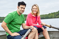 Couple in a rowboat Stock Photo