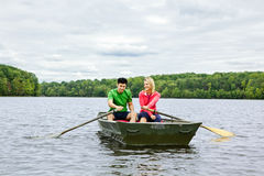 Couple in a rowboat. A couple in a rowboat on a lake Royalty Free Stock Photo