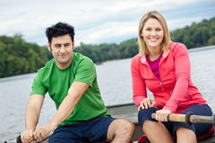 Couple rowing a boat Royalty Free Stock Image