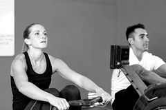 Couple on rowing machine - crossfit workout Royalty Free Stock Images