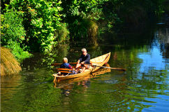 Couple Rowing row boat over Avon River Christchurch - New Zealan Royalty Free Stock Photography