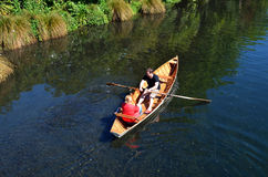Couple Rowing row boat over Avon River Christchurch - New Zealan Stock Image