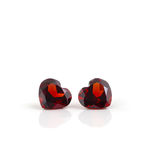 Couple of ruby heart gemstones. Royalty Free Stock Photography
