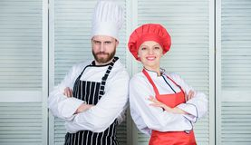 Couple ruling the culinary world. Family cooking in kitchen. man and woman chef. secret ingredient by recipe. cook. Couple ruling the culinary world. Family stock images
