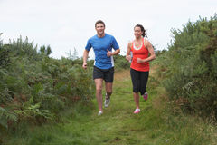 Couple On Run In Countryside Stock Photos