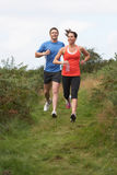 Couple On Run In Countryside Stock Photo