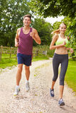 Couple On Run In Countryside Together Royalty Free Stock Images