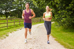Couple On Run In Countryside Together Royalty Free Stock Photography