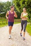 Couple On Run In Countryside Together Stock Image