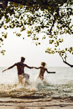 Couple run on the sea Royalty Free Stock Photography