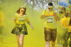 Couple runing at Color Run in Bucharest Royalty Free Stock Photography