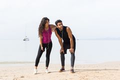 Couple Of Runner Having Rest After Training On Beach Man And Woman Sport Runners Standing Fit Male And Female Fitness Royalty Free Stock Image