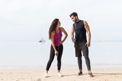 Couple Of Runner Having Rest After Training On Beach Man And Woman Sport Runners Standing Fit Male And Female Fitness Stock Image