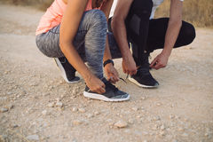 Couple of runners getting ready for outdoor training Royalty Free Stock Photography