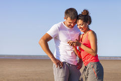 Couple of runners listening to the music training outdoors worki Royalty Free Stock Image