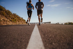 Couple of runners on morning run Royalty Free Stock Photo