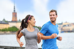 Couple runners running in Stockholm city, Sweden Stock Images