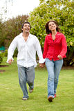 Couple running Stock Image