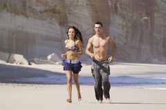 Couple running. Couple relaxing and running in the beach Stock Images
