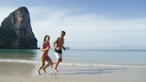 Couple Running Along Beach, Happy Couple Smiling Tourists On Sea Vacation. Slow Motion 120 stock footage