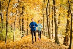 Couple running in autumn nature Stock Photography