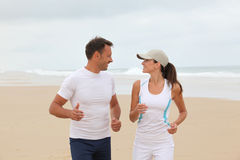 Couple running on the beach Stock Photography