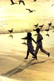 Couple running in the beach Royalty Free Stock Photography