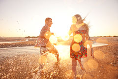 Couple running on the beach. Happy couple running on the beach Royalty Free Stock Image