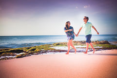 Couple running at the beach. Happy couple running at the beach Royalty Free Stock Photos