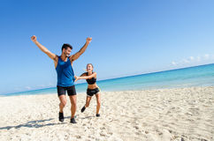 Couple running at the beach. Happy couple running at the beach Stock Photo