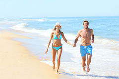 Couple running on the beach Royalty Free Stock Photo