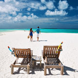 Couple running on a beach at Maldives Stock Photos
