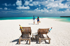Couple running on a beach at Maldives Stock Image