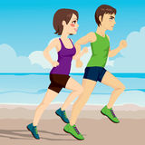 Couple Running On Beach. Side view illustration of young couple running together on the beach Stock Photos