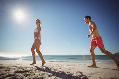 Couple running on beach. Young couple running on beach in summer Stock Photos