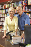 Couple running bookshop. Looking happy and relaxed Stock Photos