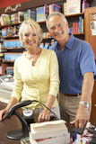 Couple running bookshop. Smiling at camera Royalty Free Stock Image