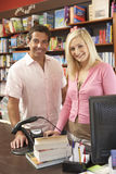 Couple running bookshop Stock Photography