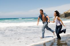 Couple Running By The Seaside In The Beach Royalty Free Stock Image