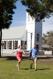 Couple Running By Church Stock Photography