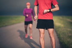 Couple running on country road Stock Photography