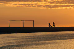 Couple running at dawn on the beach Royalty Free Stock Image