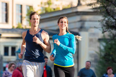 Couple running in Dresden inner city Royalty Free Stock Images
