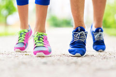 Couple running feet close-up Royalty Free Stock Images