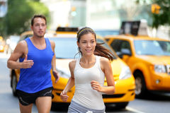 Couple running on fifth avenue, New York NYC. Active couple running on famous shopping street fifth avenue in Manhattan, New York City NYC, USA. Exercise Stock Image