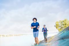 Couple running or jogging outdoor stock photo