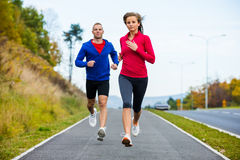 Couple running, jumping outdoor Stock Photo