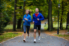Couple running, jumping outdoor Royalty Free Stock Photography